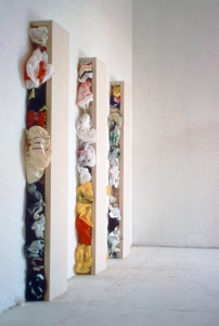 "<span class=""artworktitle"">Work in Progress</span><span class=""artworkcaption""><br/>plastic bags, canvas, wood<br/>each stretcher 60 h x 8 w x 6 d in.<br/>1998</span>"