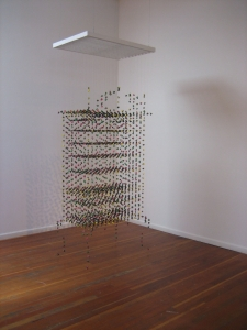 "<span class=""artworktitle"">Veneer</span><span class=""artworkcaption"">, Mission 17 Gallery San Francisco, 2009<br/>acrylic paint on hung monofilament, wood support<br/>120 h x 40 w x 25 d in.<br/>2008</span>"