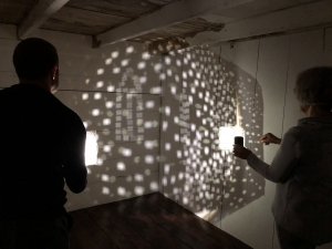 "<span class=""artworktitle"">Dark Matter House</span><span class=""artworkcaption"">, collaborative performance<br/>lunettes drawings, flashlight, performance score, sound installation<br/>2018</span>"